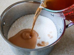 Tomato Chili and Ginger Jam Recipe - pouring red wine vinegar into sugar