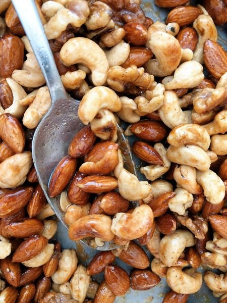 Coating the Nuts in Sweet Spice Mixture - Sweet Salty Spicy Nuts Recipe